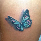 butterfly groin tattoo