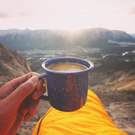 Hot tea in the mountains at sunrise
